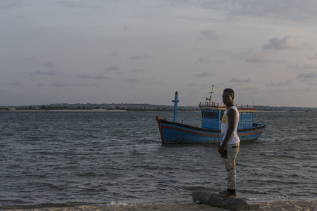 MUSSULOANGOLA-14 DEC 2014 - Young african fisherman on the tropical island of the mussulo. Angola Stock Photo