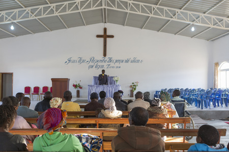 hymnal: LUBANGOANGOLA - 13 JULY 2016 - African church in Angola, with natural light from the windows