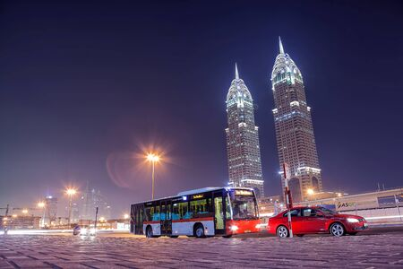 26: UAEDUBAI - 26 SEP 2012 - Bus stop with twin towers in background. City of Dubai, Internet city. Editorial