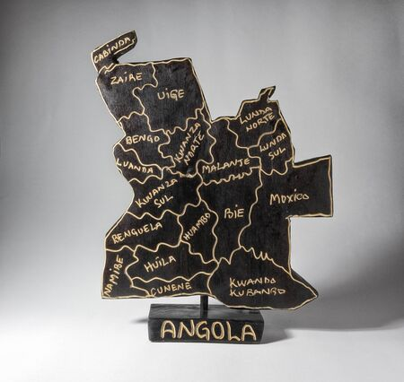 Wooden sculpture of Angola map, isolated on white background