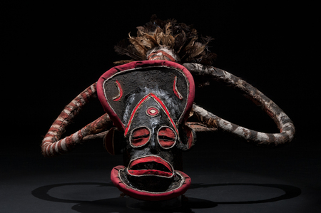 African mask of cloth, traditional, isolated on black background. Stock Photo