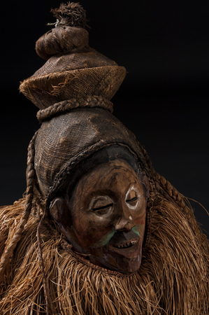 African wooden masks. With hair. Isolated on black background.