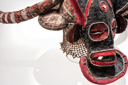 African mask of cloth, traditional, isolated on white background.