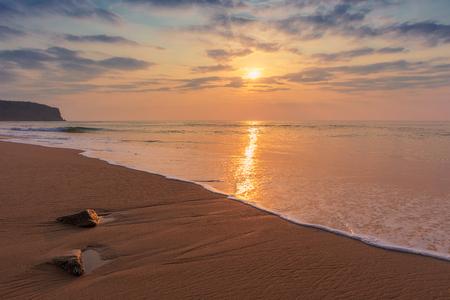Beautiful sunset at cabo ledo beach Angola. With waves. Dramatic sky. Stock Photo