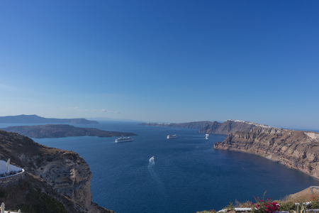 Beautiful view of Caldera with passenger cruises. Santorini, Greece.