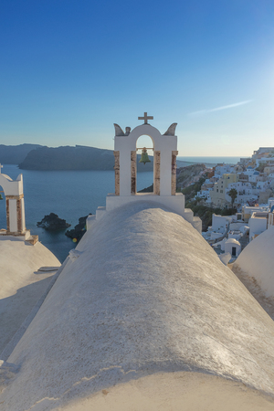 Church bell in oia, Santorini. Sunset. Greece. Stock Photo