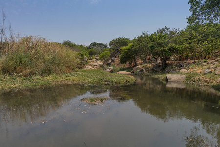 fluent river with rocks and vegetation in Africa. Lubango. Angola.
