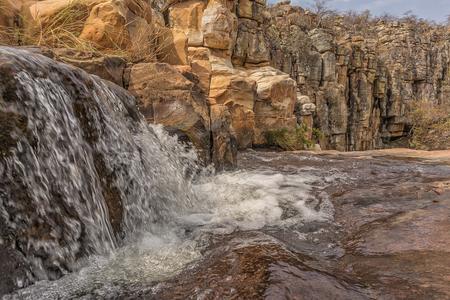 Waterfalls with rocks in the canyon of Leba. Angola. Lubango.