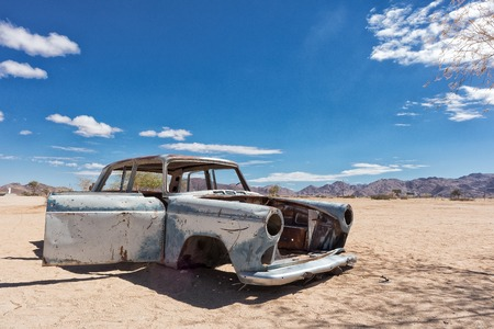 Old and abandoned car in the desert of Namibia, spot known as solitaire. Banco de Imagens