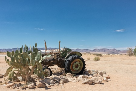 old abandoned tractor in the Namibia desert. Local known as solitaire. Stock Photo