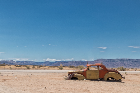 Old and abandoned car in the desert of Namibia, spot known as solitaire. Stock Photo