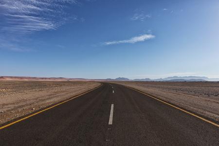 Asphalt road crossing the Namibia Desert on the way to Sossusvlei.