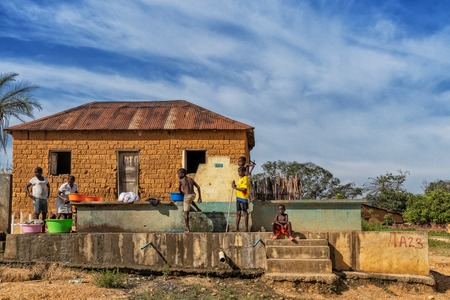 MALANJE/ANGOLA - 10 MAR 2018 - African women and children washing clothes at a water source in rural Africa, Angola. Malanje. Editorial