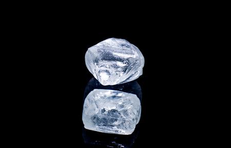 Raw diamond isolated on black background. 版權商用圖片