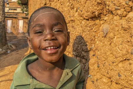 NDALATANDO/ANGOLA - 27 JUL 2017 - Portrait of African Boy in the alleys of rural village.