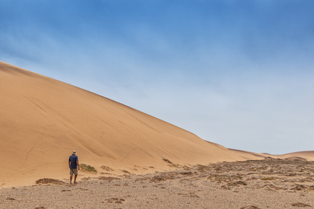 Man walking in the Namibe Desert. Africa. Angola.