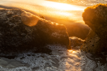 Marine swimming pool formed by rocks on the beach with beautiful sunset light. Namibe. Africa. Angola