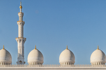 Top of tower and dome of arab mosque in Abu Dhabi. UAE.