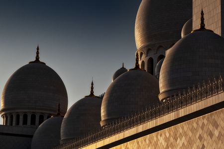 Cupolas in great mosque, abu dhabi, with sunset light