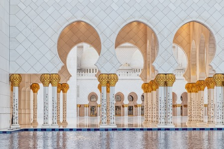 Arabic mosque arch, with sunset light.Great Mosque. UAE. Abu dhabi.