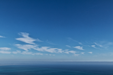 Calm ocean with blue sky and clouds. 免版税图像