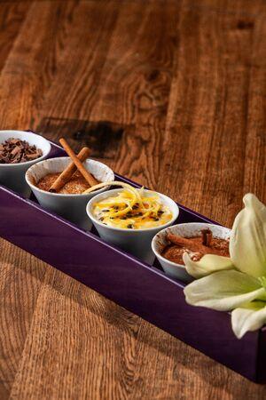 Dessert Tray on Wooden Table Foto de archivo - 127926280