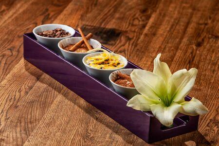 Dessert Tray on Wooden Table Foto de archivo - 127926288