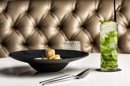 Beautiful and delicious risotto with fish medallions. Accompanied by a beautiful mojito.