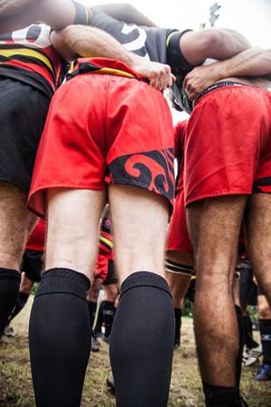 POINTNOIRE / CONGO - 18MAY2013 - Equipo de amigos aficionados jugando al rugby Editorial