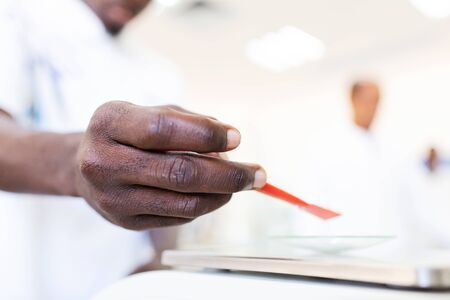 African scientist hand testing in the laboratory.