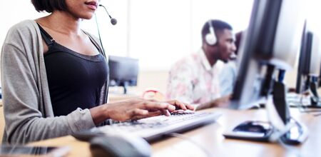 African woman in call center.