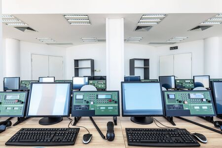 Control room with machines and computers.