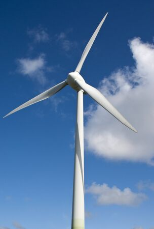 Vertical wind generator on a blue sky background