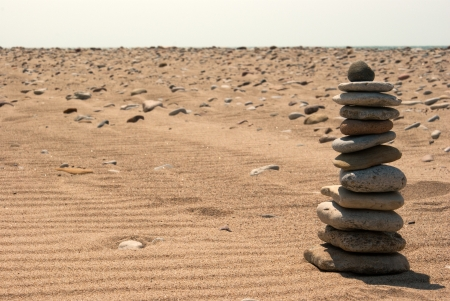 Background with sand, stones, sky and sones pyramid  Stock Photo