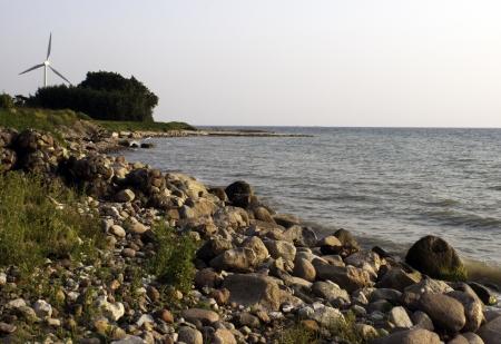 Windmill on rocky coast in Liepaja, Latvia Stock Photo