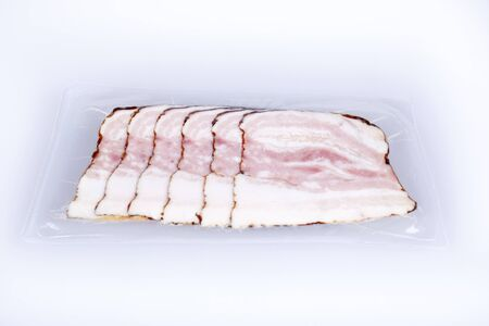 Slices of bacon, in vacuum box photo