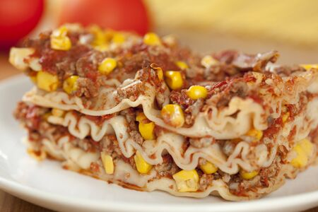 Lasagne with meat, corn and mushrooms photo