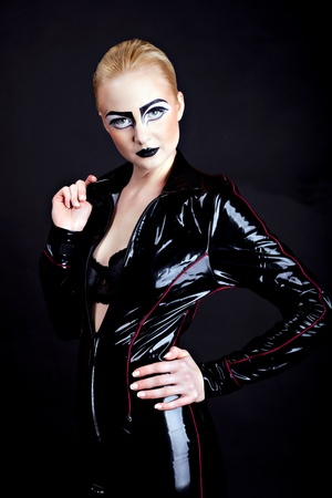 woman in latex, attractive domina on black photo