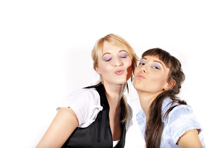 Two beautiful laughing sexy and smiling girls kissing you, isolated on white background photo