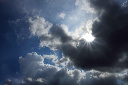 Sun burst in nice blue cloudy sky