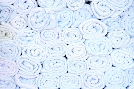 Rolled up towels grouped together in a stack 版權商用圖片