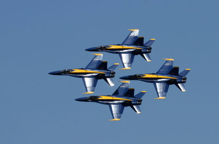 Airplanes flying in an airshow photo