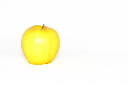 Yellow apple with white background
