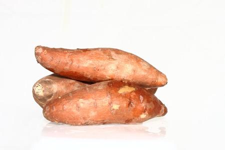 3 Sweet potatoes on a plain white background