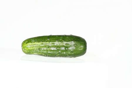 Single cucumber on a plain white background