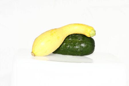 cucumber and squash on a plain white background 版權商用圖片