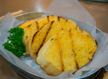 side order: Garlic bread. Stock Photo