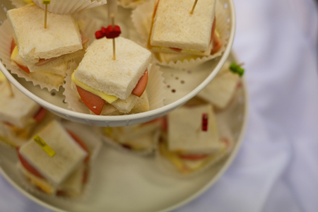 Close up mini Sandwich with Toothpick in  Shelf on the white table.