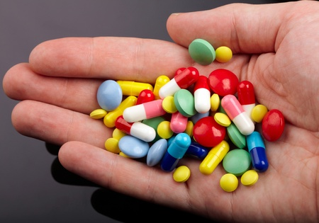 Hand with colorful pills Stock Photo - 11446681