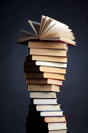 published: Pile of books on a black background Stock Photo